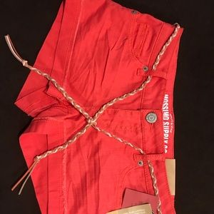 Brand new never worn coral shorts with a belt